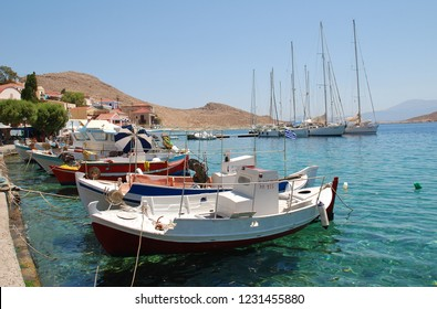 HALKI, GREECE - JULY 14, 2016: Small boats moored in Emborio harbour on the Greek island of Halki. The island is a destination for daytrippers from Rhodes.