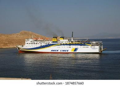 HALKI, GREECE - JULY 19, 2016: ANEK Lines ferry boat Prevelis arrives at Emborio harbour on the Greek island of Halki. The 142.5mtr vessel was built in 1980 in Japan.