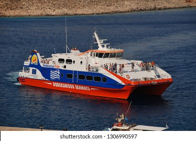 HALKI, GREECE - JUNE 8, 2017: Dodekanisos Seaways high speed catamaran ferry Dodekanisos Pride arrives at Emborio harbour on the Greek island of Halki. The 40.05mtr vessel was built in 2005 in Norway.