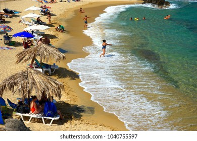 HALKIDIKI, GREECE- SEPTEMBER 03, 2016 - People on beautiful  beach, view from beach bar, Sithonia