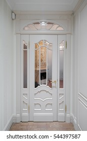 Hall in the flat. Wooden design, white colors. Wooden floor.