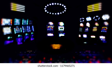 A hall full of slot machines, glowing lights, darkness and gambling threats.