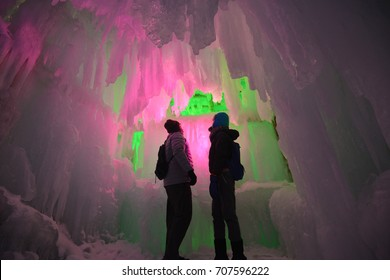 In the hall room Illuminated ice cave with tourist at Snow Festival Sapporo, Hokkaido, japan.