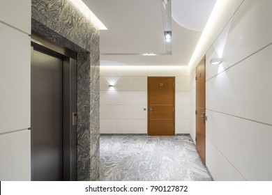 Hall staircase and elevator in a modern block of flats.