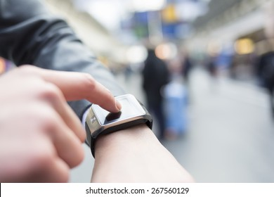 In hall station a man using his smart watch app. Close-up hands