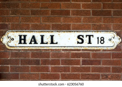Hall Street British Vintage Street Signs against Red Brick Wall Shallow Depth of Field