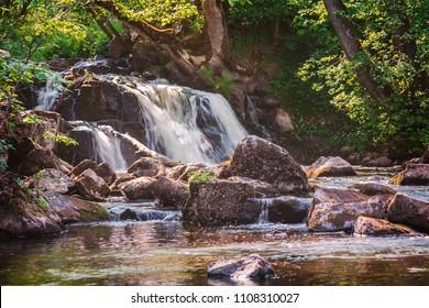 Hallamolla forest waterfall in Skane, Sweden.