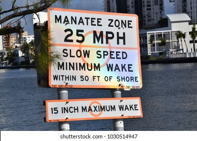 Hallandale, Florida - January 11, 2018: Sign on intercostal waterway indicating Manatee Zone on this date
