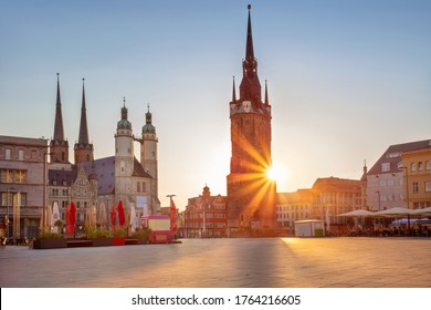 Halle, Germany. Cityscape image of historical downtown of Halle (Saale) with the Red Tower and the Market Place during beautiful summer sunset.