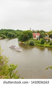 Halle, Germany - June 13, 2011:  Saale River in the city of Halle with a ship and in the background the Giebichenstein Fortress in Germany