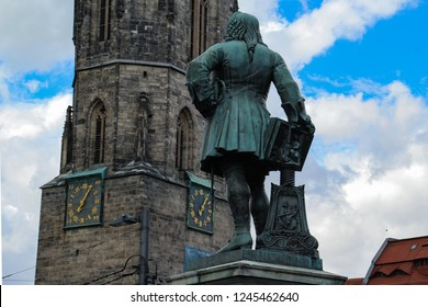 Halle (Saale) city with square Hallmarkt and church Marktkirche, monument of famous German composer George Frideric Handel in Halle (Saale) Marktplatz, Germany