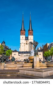 Halle (Saale), Germany - April 20, 2018: View of Market Church of Our Dear Lady or Marktkirche Unser Lieben Frauen and Gobel Fountain at blue sky, sunset