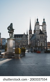 HALLE (SAALE), GERMANY - Jun 14, 2021: Haendeldenkmal and the Marktkirche at the marketplace in Halle (Saale), Germany