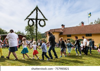 HALLESAKER, SWEDEN - JUNE 20, 2014: Midsummer is being celebrated at Borjesgarden with dancing around the maypole. Midsummer is the biggest traditional holiday in Sweden.