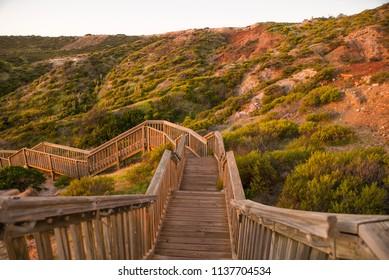 Hallett Cove Conservation Park wooden walking boards around Sugar Loaf Geological Australian heritage at sunset