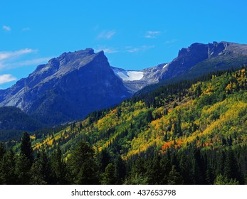 hallett peak and colorful aspen trees in fall in  in rocky mountain national park, colorado