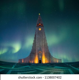 hallgrimskirkja is one of the highest and most famous lutheran church in Reykjavik,Iceland. It is design by Icelandic architecture. There is green northern light and aurora borealis, galaxy background