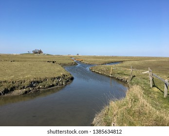 The Hallig Hooge in Germany is well known for its tidal creeks and marsh meadows. It is situated in the North Sea and belongs to the World Natural Heritage Wadden Sea.