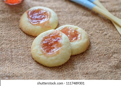 "Hallongrotta is the name of a common Swedish pastry. The name means ""Raspberry cave"" in Swedish. In the United States they are known as thumbprint cookies."