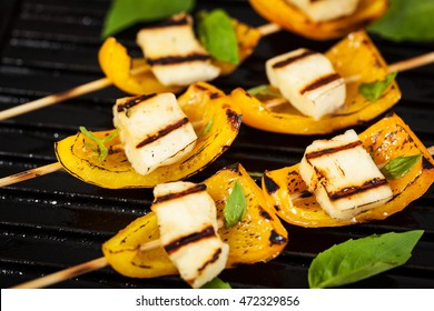 Halloumi cheese and bell pepper skewers appetizer on grill