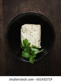 Halloumi Cheese in a Black Bowl.