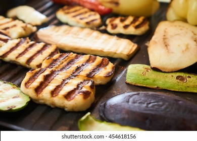 Halloumi cheese and vegetables on a grill, healthy cooking