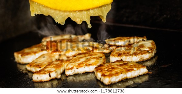 Halloumi on the grill with freshly squeezed lemon