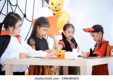 Halloween activities for cute children in school while are helping to devise toys to participate in activities. Childhood with cheerful and happiness with friends. Fancy dress and makeup for child.