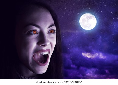 Halloween angry vampire woman in night sky with moon. Horror theme.