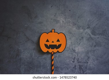 Halloween art jack o lantern sign on grunge dark stone background with copy space, holiday concept