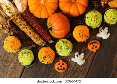 Halloween Background / Autumn background with pumpkins and Halloween treats