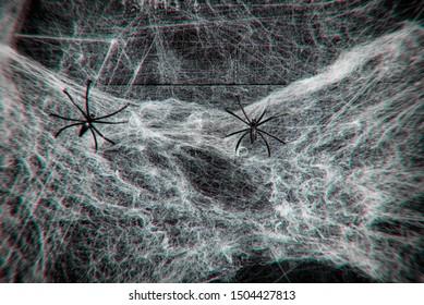 Halloween background horror decoration spider web and black spider on wooden dark background on holiday with filter blur effect
