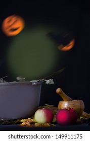 Halloween background with mortar, apple and pumpkin