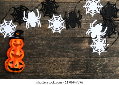 Halloween background/ Halloween pumpkin Jack O and spider web on grunge wood texture backgrond