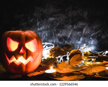 Halloween background with pumpking and autumn leaves