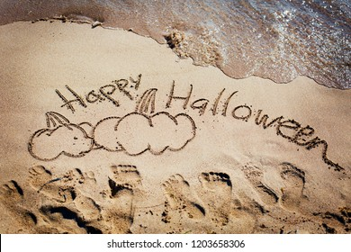 Halloween background with pumpkins on the sandy beach