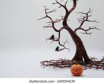 Halloween background. Space for text.Silhouette dead tree on dark dramatic sky background for scary or death. Hopeless, despair,sad and lament concept. Scary forest. Dramatic horror night on Halloween