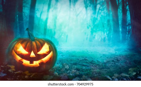 Halloween background. Spooky forest with dead trees and pumpkin.Halloween design with pumpkin