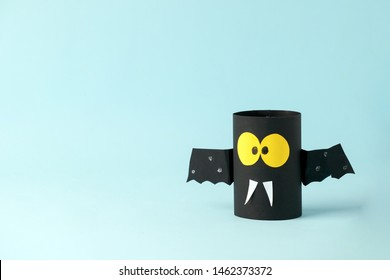 Halloween bat on blue for Halloween concept background. Paper crafts / DIY. Handcraft creative idea fron toilet tube, recycle concept