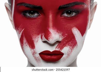 Halloween beauty makeup. Girl with red lips and blood on face