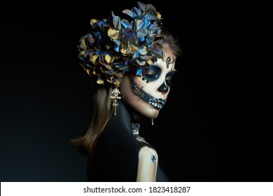 Halloween beauty portrait of a skeleton woman of death, the makeup on the face. Day of The Dead. Charming and dangerous Calavera Catrina