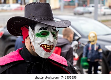 Halloween bike ,  men in masks, parade participants