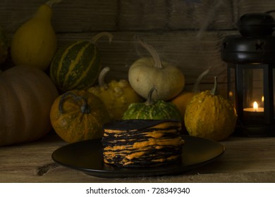 Halloween cake of pancakes on a background of scenery Halloween