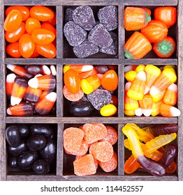 Halloween candy arranged in a printers box, assorted varieties