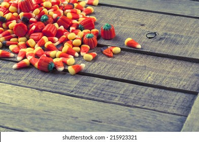 Halloween Candy Corn in Pile Spread on Rustic Textured and Weathered Wood Background with room or space for copy, text, your words.  Horizontal instagram