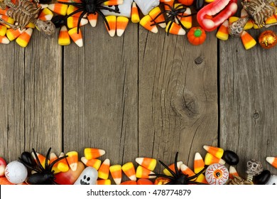 Halloween candy and decor double border against a rustic wood background