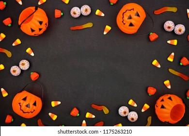 Halloween candy frame over a dark black background. Copy space.
