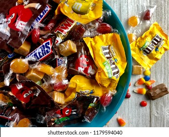 Halloween candy in a plastic bowl