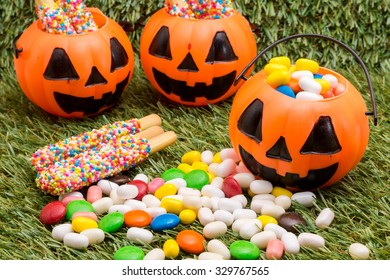 a halloween candy with pumpkin jack on grass background for halloween use (selective focus technique applied)