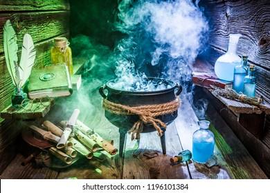 Halloween cauldron with blue and green smoke